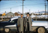 Two men standing near car in Anchorage, Alaska.