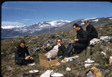 Men having a picnic at Baffin Island.