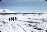 People walking in snow at Iliamna, Alaska.