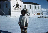 Man in front of RCMP office, Frobisher Bay.