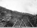 Quarrying rocks for rip rap purposes at mile 85, Turnagain Arm, April 11, 1919.
