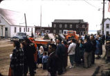 People waiting for parade in street at Nome, 7/4/57.