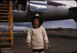 Child in front of airplane, Baffin Island.