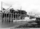 Cannery tender at low tide, Anchorage, 1941.