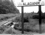 Railroad mileage sign, Alaganik, Alaska, ca. 1915-1930.