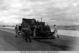 Spreading asphalt at 26-Mile Airbase, 1947.