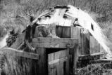 An Aleut house, used the summer time. A sweat-house in the rear.