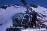 Man standing on a Hiller UH-12E helicopter, 1962.