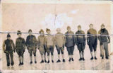Group portrait of U.S. Army servicemen on ice skates.