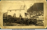 R.T. Harris and family in front of home on Courthouse Hill in Juneau, 1889.