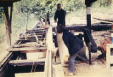 Harold and Roxy Pomeroy in the sawmill at Bear Cove.