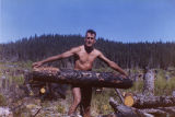 Harold Pomeroy lifting a log at Bear Cove.