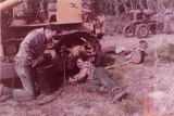 Harold and Roxy Pomeroy fixing a tractor at their Bear Cove homestead.