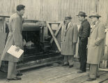 Harold Pomeroy examining an engine for Alaska Territorial Civil Defense.