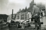 Harold Pomeroy pushing a cart at Bear Cove.