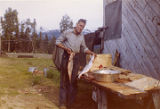 Harold Pomeroy displaying salmon at Bear Cove.
