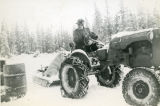 Harold Pomeroy on his tractor at Bear Cove in winter.
