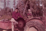 Harold Pomeroy cutting logs.