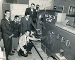 Harold Pomeroy and other men examining the Big Delta fire truck.