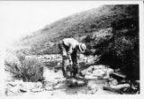 Unidentified man gold-panning.