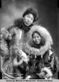 Man and woman dressed in fur.