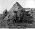Eskimos and their walrus skin igloo, Nome, Alaska.