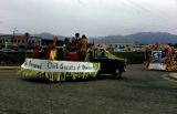 Parade floats for German Club of Anchorage and the Girl Scouts of America.