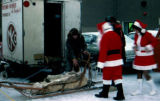 Joe Redington Sr. prepares to give Santa Claus a dog sled ride.