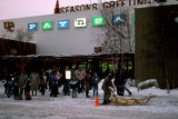 Joe Redington Sr. giving dog sled rides at University Center Mall.
