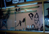 Museum display, including skis and snowshoes in displieon snow travel.