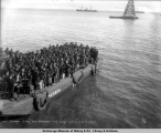 Passengers landing from S.S. Senator, first barge, June 16, [19]08, Nome, Alaska.