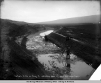 Sutton's Ditch on Penny R[iver], 11.650, looking down st[ream], Aug. 8, 1905, Nome, Alaska.