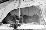 Whale hunters sleeping on walrus hide, sleep in clothing, Pt. Barrow, 1921.