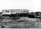Members of Co. B, 28th Engineers, before railroad car used as a dining car, Yakutat landing field,...