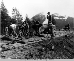 U.S. Army Corps of Engineers personnel build sandbag defenses against flooding in the Girdwood...