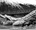 Collapsed road bridge, Girdwood area, Alaska, after the 1964 earthquake.