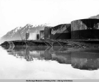 Damaged tanks and railroad tracks, Seward, Alaska, March 1964.