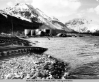 Damaged waterfront, tanks, and railroad tracks, Seward, Alaska, after the 1964 earthquake and...
