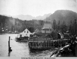 Reynolds Alaska Dev[opment] Co.'s wharf and buildings at Horse Shoe Bay, Latouche Island, Alaska.