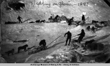 Sledding on glacier, 1899.