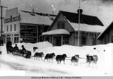 Malamoot Kid's dog team in front of cable office, Valdez, Alaska.