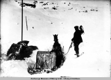 Horse and sled stuck in snow.