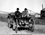 Two men in a motor car near Nome, Alaska, 1909.