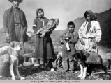 Alaska Native family with pack dogs.