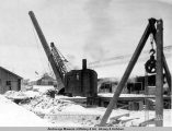 Conveying smokestack to the steam heating plant, A.E.C. yards, Anchorage.