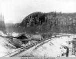 A.E.C. R[ailwa]y barn, grain cache and town, King [sic] River, Alaska.