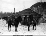 C.R. Breck, Dist. Engineer [and] E.O. Archibald, Asst. Dist. Eng., at Camp 24, King [sic] River,...