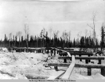North end of wagon road bridge, Camp 174, A.E.C. R[ailwa]y, Mar. 27, [19]17.