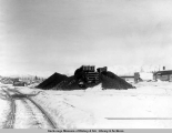 A.E.C. R[ailwa]y coal cache, Anchorage, Alaska, Mar. 1917.