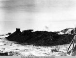 A.E.C. R[ailwa]y coal cache, Anchorage, Alaska, March 1917.